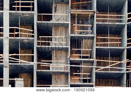 close-up of the construction of a house made of cast-in-place concrete and panels. Construction of walls of foam blocks of bricks. Concept skeleton erection of multi-storey apartments.