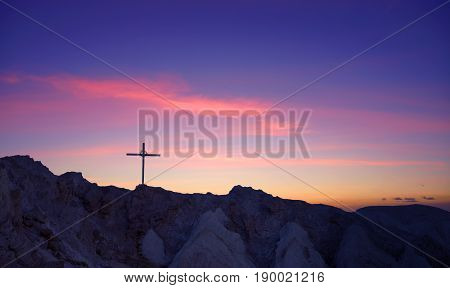Cross at sunrise or sunset concept of religion
