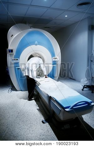 Radiologist in the room, magnetic resonance therapy in the hospital. Concept diagnosis cancer disease.