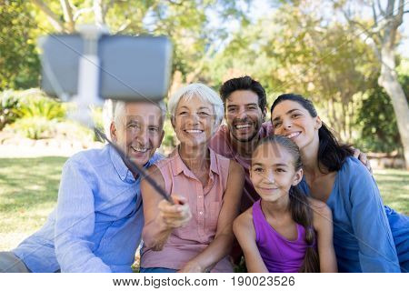 Smiling family taking a selfie in the park