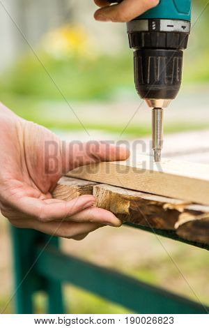 Man working with an electric screwdriver. DIY concept.