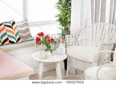 Interior of modern veranda with cozy furniture