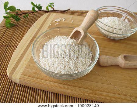 Tapioca sago pearl in bowl on wooden board