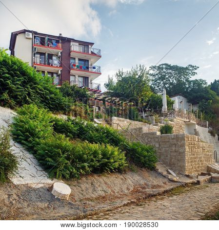 Nesebar Bulgaria - September 05 2014: Architecture and cobbled stone pavement in Old town Nesebar. Seaside resort Nessebar. Bulgarian Black Sea Coast. Architectural and Historic Complex. UNESCO world heritage site.