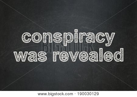 Political concept: text Conspiracy Was Revealed on Black chalkboard background