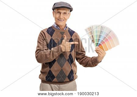 Senior holding a color swatch and pointing isolated on white background