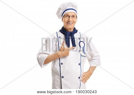 Happy chef with an award ribbon pointing isolated on white background