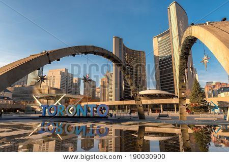 Toronto city hall and Toronto Sign in downtown at sunset, in Toronto, Ontario, Canada