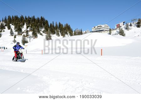 Men On Snowmobile At Engelberg On The Swiss Alps