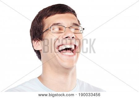 Face close up of young hispanic man wearing glasses and blue shirt laughing over white background - laughter is best medicine concept
