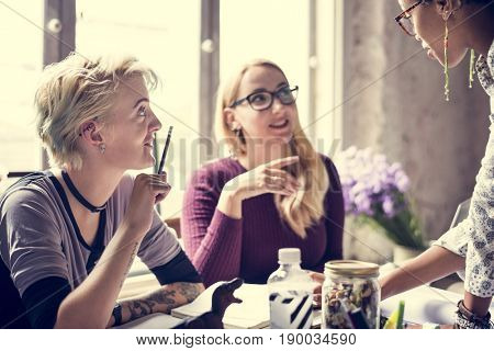 Colleagues Exchanging Opinion Ideas Working