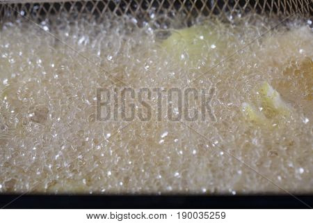Foam from oil whan Onion being cooked in electric fryer