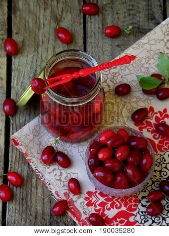 Canned Of Dogwood Cornelian Cherry Berry On Wooden Background. Selective Focus