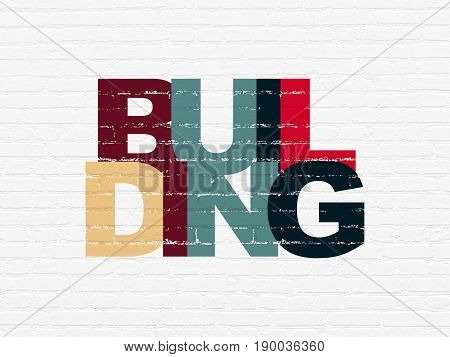 Constructing concept: Painted multicolor text Building on White Brick wall background