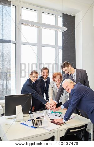 Business team with successful team spirit stack hands together