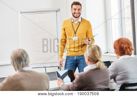 Lecturer makes a business presentation with flipchart about consulting