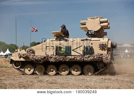 WESTERNHANGER, UK - JULY 18: An ex British army Milan missile tank gives a demonstration in the main arena to the watching public at the War & Peace Revival show on July 18, 2014 in Westernhanger