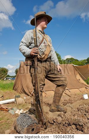 DENMEAD, UK - MAY 25: An Australian infantry re-enactor from the WW1 period stands on the parados of the trench system at the Overlord show on May 25, 2014 in Denmead