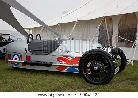 NEWBURY, UK - SEPTEMBER 21: A three wheeler Morgan sports vehicle is placed on public display as part of a trade stand show at the Berks County show on September 21, 2013 in Newbury