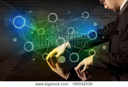 Male hands touching interactive table with colorful world map on it
