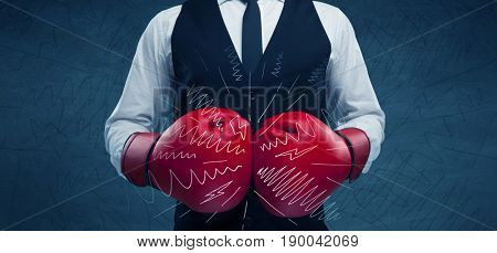 A confident businessman standing in red boxing gloves on his hand in front of blue wall background with drawn strength lines illustration concept.