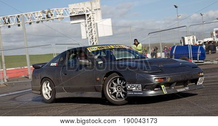 PODINGTON, UK - FEBRUARY 22: An unnamed driver gives drifting rides to members of the public at the annual Stuntfest event at Santa Pod Raceway on February 22, 2014 in Podington