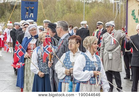 VERDAL NORWAY - MAY 17 2017: National day in Norway. Norwegians at traditional celebration and parade on may 17 2017 in Verdal. People on parde before school in Verdal. Constitution Day is the National Day of Norway and is an official national holiday.