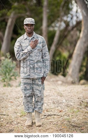 Mid section of soldier taking pledge in boot camp poster