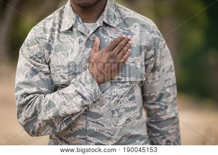 Mid section of soldier taking pledge in boot camp