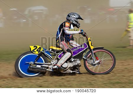 ALVELEY,UK - MAY 7: A rider competing in the Bewdley MCC spring grasstrack meeting exits the bottom corner in a cloud of dust on May 7, 2017 in Alveley