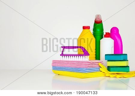Range of cleaning products for the home. Detergents, chemical bottles, cleaning sponges and gloves. on a white background.