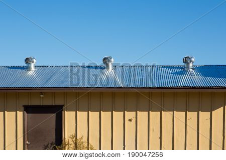 Air Ventilator On The Roof Of Factory.natural Roof Ventilators On The Roof Top Spinning And Take Coo