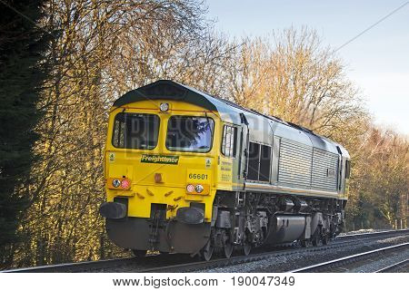 CROPREDY, UK - DECEMBER 29: A class 66 freight loco passes Cropredy crossing on route to the West Midlands on December 29, 2014 in Cropredy. Freightliner operate a fleet of 80 locos & 1400 wagons