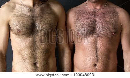 closeup of two men standing next to each other with naked chest