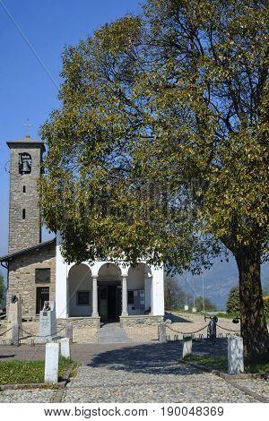 Church of Madonna del Ghisallo at top of the famous Ghisallo pass (Como Lombardy Italy). The Madonna del Ghisallo is the protector of the cyclists
