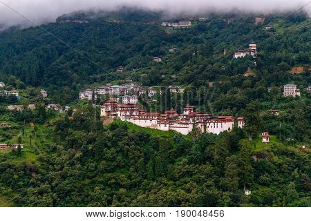 View Of Trongsa Dzong And Ta-dzong With Foggy Hills, Bumthang, Bhutan, Asia.