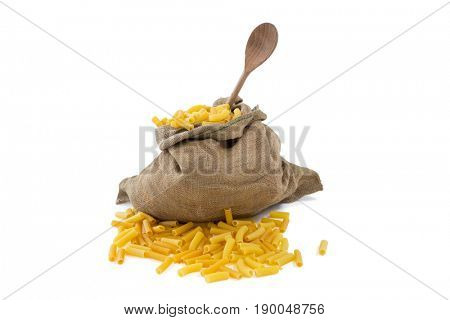Clos-up of raw pasta in sack against white background