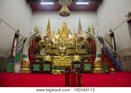 Thai People Respect Praying And Gild Cover With Gold Leaf On Luang Pho Ban Laem Statue