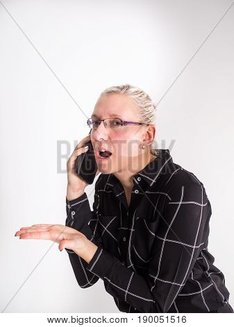 young angry casual woman calling on the phone