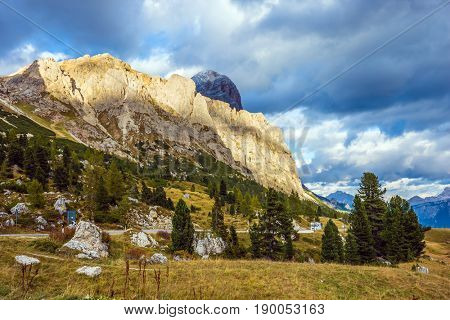 Day of fall. Travel in the Dolomites. To pass Faltsarego approaching snowstorm. Concept of active and extreme tourism
