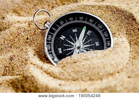 concept compass in sand searching meaning of life close up