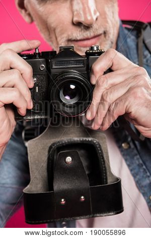 Partial View Of Man Holding Retro Photo Camera In Hands Isolated On Pink