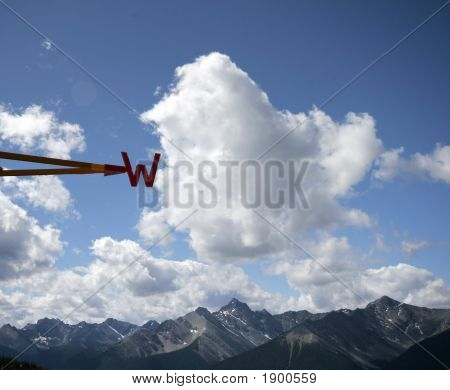 West - Direction Letter Against A Blue Sky