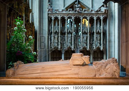 Gloucester United Kingdom - June 8 2013: View of tomb of Osric anglo-saxon King of the Hwicce in Gloucester Cathedral which is founded by him in the year 678.