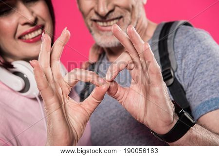 Close Up View Of Smiling Couple Showing Okay Sign Together Isolated On Pink