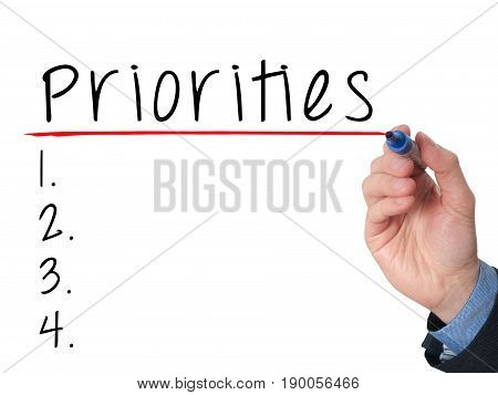 Business Man Hand Writing Priorities List With Marker Isolated On White