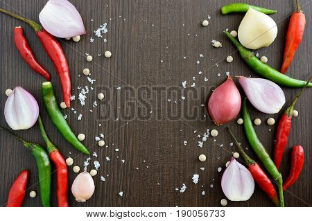 Asian cuisine ingredients food top view spice onion garlic chili pepper salt for cooking original eastern foods style on top wood texture background Thailand food spices