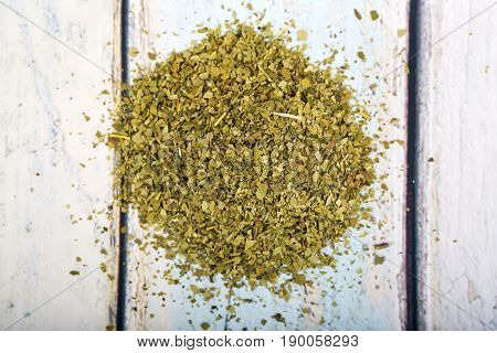 Dry mate tea isolated on wooden background.