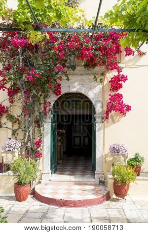 Entrance to the church in Monastery of of Virgin Mary in Paleokastritsa, Corfu island in Greece.