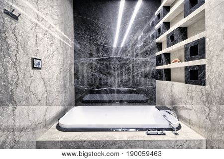 Black-and-white marble in the interior of a modern bathroom in a luxury apartment.